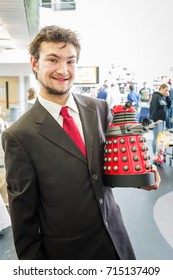 Carlisle, UK - August 19, 2017: Cosplayer dressed as Doctor Who holding a mini dalek at  Megacon in Carlisle.