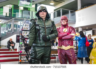 Carlisle, UK - August 19, 2017: Cosplayers dressed as Green Arrow from  'Arrow' and The Flash from 'The Flash' at Megacon convention in Carlisle.
