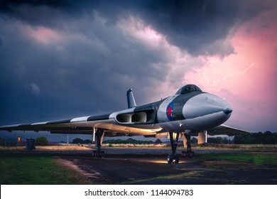 CARLISLE, UK, JULY 27 2018: A photograph documenting lightning bolts in an electrical storm above a retired Avro Vulcan as it lies as a static display at Carlisle Airport