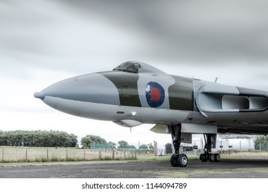 CARLISLE, UK, JULY 27 2018: A long exposure photograph documenting an electrical storm above a retired Avro Vulcan as it lies as a static display at Carlisle Airport