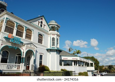 """CARLSBAD, CA - JANUARY 26: """"Twin Inns"""" built in 1887 in Queen Anne architectural style. Former mansion of Gerhard Schutte, co-founder of Carlsbad. As of January 26, 2009, the building is now a restaurant."""