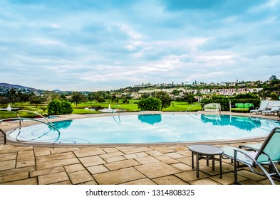 Carlsbad, CA / USA - 11-09-2014: Oval shaped pool facing golf course at luxury resort in Carlsbad, California.