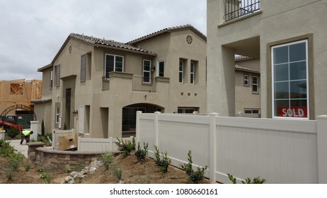 Carlsbad, CA / USA - April 30, 2018: A new home is already sold as construction is still under way