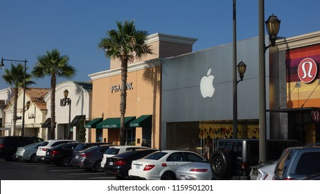 Carlsbad, CA / USA - August 17, 2018: The Apple Store and other shops in the Carlsbad Forum