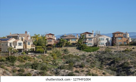 Carlsbad, CA / USA - January 9, 2019: Newer homes in an affluent suburb of San Diego sit on the edge of a canyon that is recovering from 2014 wildfire