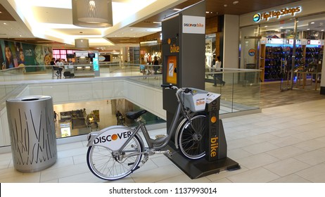 """Carlsbad, CA / USA - July 18, 2018: A Discover Bike station inside """"The Shoppes at Carlsbad"""" mall"""