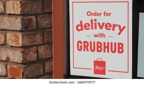 Carlsbad, CA / USA - March 28, 2020: Sign for Grubhub delivery on a restaurant window
