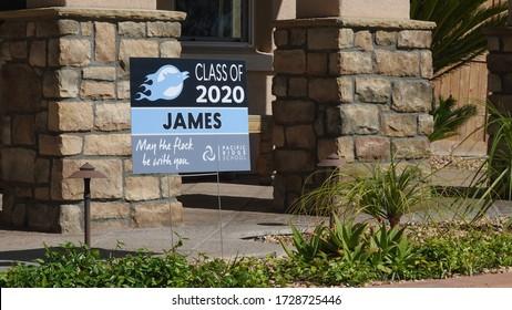 Carlsbad, CA / USA - May 11, 2020: A yard sign celebrates a 2020 graduate during pandemic shutdown.
