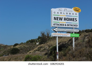 Carlsbad, CA / USA - May 3, 2018: A sign for new homes for sale in Carlsbad, California