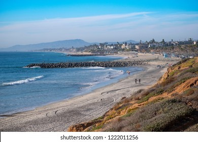 Carlsbad, California / USA 11- 04-2018 Surfers and vacationers enjoy the world famous beaches and surf of the destination resort town of Carlsbad  California.