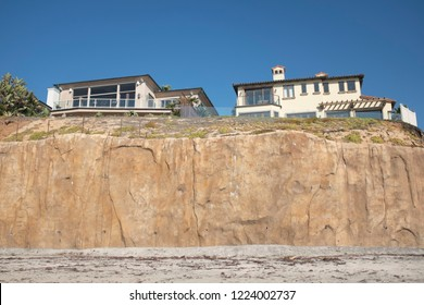 Carlsbad, California / USA 11-06-2018 A Sea Wall protects two homes on the coast in Carlsbad California. Sea walls are used to stabilize sandy bluffs protecting homes from a possible bluff collapse.
