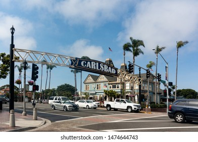 Carlsbad, California / USA - 14 ‎July ‎2017: Carlsbad gateway sign with the Historic Twin Inn mansion in the background, housing the Sun Diego Boardshop store and The Land & Water Company restaurant.
