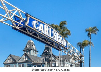 Carlsbad, California, USA - Jan. 24, 2016: City of Carlsbad welcome sign. Large archway sign. Downtown lankmark. Village Faire shopping center in the background.