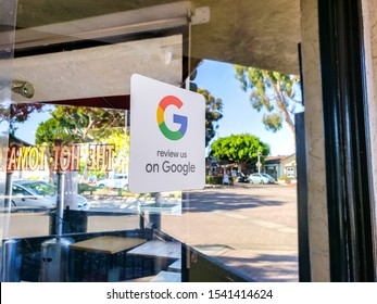 Carlsbad, California/United States - 10/08/2019: A retail store window sticker advertising to guests and customers to provide reviews on Google Maps