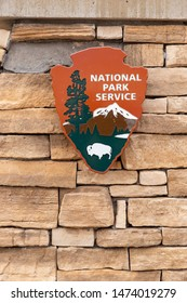 Carlsbad, NM / USA - July 11, 2019: National Park Service logo on rock sign