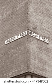 Carlton and Broad Street Signs; Nottingham; England; UK in Black and White Sepia Tone