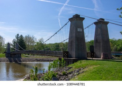 Carlyle, IL—May 7, 2018; historic General Dean Suspension Bridge spans the kaskaskia river on sunny day