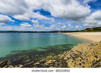 Carlyon Bay in St Austell, Cornwall, UK. This is an idyllic and once popular beach that is just under 2 miles in length and formed through generations of mining rubble.