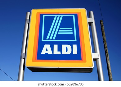 Carmarthen, Wales, UK   January 2, 2017:  Aldi logo advertising sign outside its retail supermarket stores in the city centre