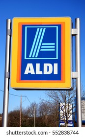 Carmarthen, Wales, UK  ?? January 2, 2017:  Aldi logo advertising sign outside its retail supermarket stores in the city centre