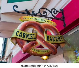 Carmel Bakery bavarian prezels sign on the facade of 1906 bakeshop dispensing European-style pastries & pretzels, coffee, soups & sandwiches - Carmel, California, USA - Circa 2019