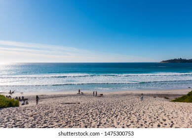 Carmel by the Sea, California - January 25, 2019: Scenic view of the beautiful and crowded beach near the famous town of Carmel-by-the-sea.