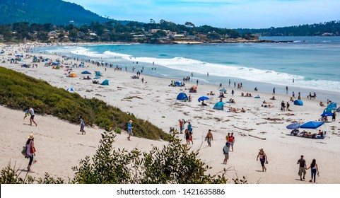 Carmel by the Sea, California - June 9, 2019:  Large numbers of people flock to Carmel Beach during an early season heat wave.