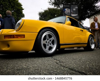 """Carmel, CA - August 21, 2018: A rare 1987 Porsche RUF CTR """"Yellow Bird"""" is parked on Ocean Avenue in Carmel during Concourse on the Avenue."""
