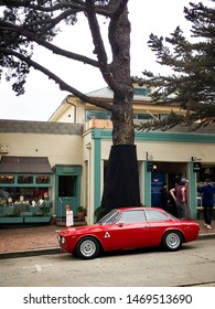 Carmel, CA - August 21, 2018: A classic Alfa Romeo is parallel parked in Carmel, CA during Monterey car week.