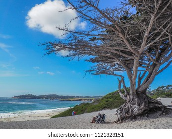 Carmel, CA / USA - September 5 2015: Beach at Carmel with a man sitting in a deck chair, Carmel, CA