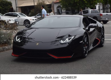 CARMEL CALIFORNIA,/UNITED STATES OF AMERICA - AUGUST 15, 2016: A Lamborghini Huracan drives through the streets of Carmel, California on August 15, 2016.