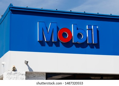 Carmel - Circa August 2019: Mobil Gas Station Signage. Mobil Merged with Exxon to Become ExxonMobil Traded as XOM I