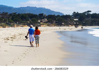 CARMEL-BY-THE-SEA, CALIFORNIA - 6 SEPTEMBER 2014: A couple stralling on a beach in Carmel-by-the-Sea, California