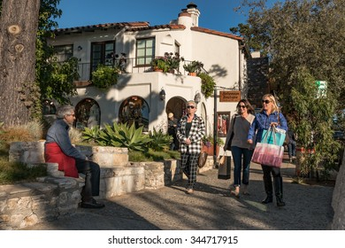 CARMEL-BY-THE-SEA, CALIFORNIA, UNITED STATES, November 28, 2015: A trio of women shoppers strolling in downtown Carmel on a November afternoon.