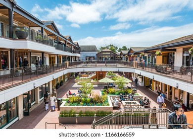 CARMEL-BY-THE-SEA, USA - May 13 2018: Shopping complex with outdoor central restaurant in Carmel-by-the-Sea, Monterey Peninsula, California a popular coastal tourist resort