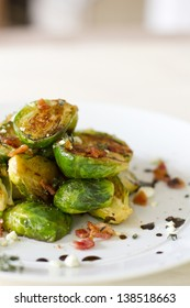 Carmelized brussel sprouts with bacon, blue cheese, thyme, and balsamic reduction.