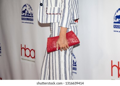 Carmen Electra with a stylish purse arrives at the 2019 Hollywood Beauty Awards at Avalon Hollywood in Los Angeles, CA on February 17, 2019.