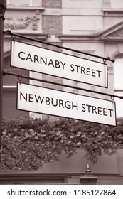 Carnaby and Newburgh Street Sign; London; England; UK in Black and White Sepia Tone