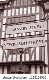 Carnaby and Newburgh Street Signs; London; England; UK in Black and White Sepia Tone