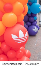 Carnaby Street, LONDON, UK - 6th July 2019 - Adidas Balloons decorate the entrance of the Adidas Store celebrating Pride In London '19.
