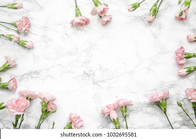 carnations flowers on a marble background