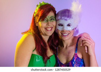Carnaval Brazil. Excited and Cheerful. Face of brazilian women with violet wig and make up mask. Bright and Colorful. Holiday concept, tradition and costume.