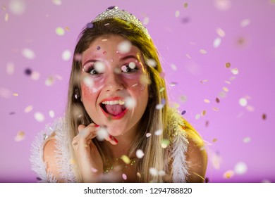 Carnaval Brazil. Excited and Cheerful. Throwing confetti. Portrait of brazilian woman with bright makeup. Bright and Colorful. Holiday concept, tradition and costume.