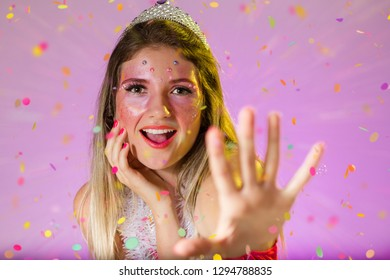 Carnaval Brazil. Excited and Cheerful. Throwing confetti. Portrait of brazilian woman with bright makeup. Bright background. Party concept, celebration and festival.