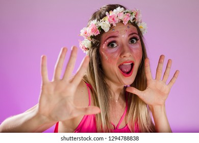 Carnaval Brazil. Hands and gesture. Face of brazilian blonde woman wearing carnival costume. Bright background. Party concept, celebration and festival.