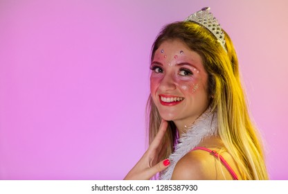 Carnaval Brazil. Happiness and Joy. Face of brazilian blonde woman wearing carnival costume. Colorful background. Carnival concept, fun and party.