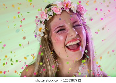 Carnaval Brazil. Throwing confetti. Excited and Cheerful. Portrait of brazilian woman with bright makeup. Colorful background. Carnival concept, fun and party.
