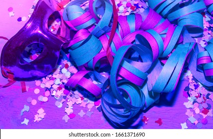 Carnaval Masques. Isolated. Colorful mask,streamers and confetti in purple soft light. Stock Image.