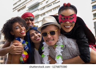 Carnaval party. Dressed crowd of Brazil people going to street Carnival. Happy brazilian partygoers in costume celebrating in parade festival.