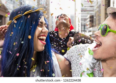 Carnaval party. Dressed group of Brazil friends going to street Carnival. Happy brazilian partygoers in costume celebrating in parade festival.